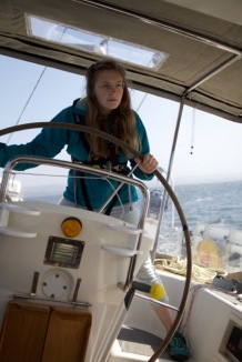 Our brave shipmate Rona at the helm of Laridae.